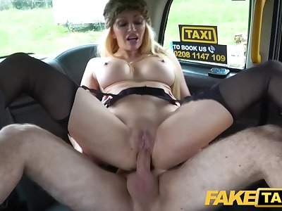 Busty blonde MILF Amber Jayne sucks and fucks big taxi cock